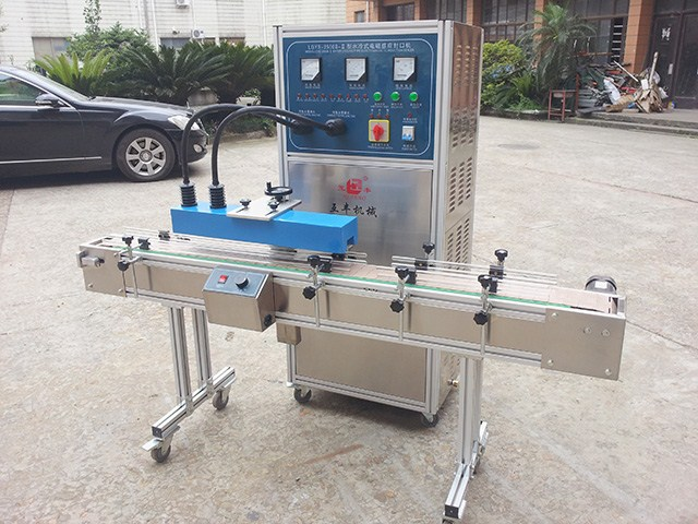 Automatic induction seal machine