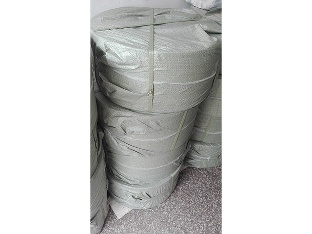 Plastic woven bag for roll material package